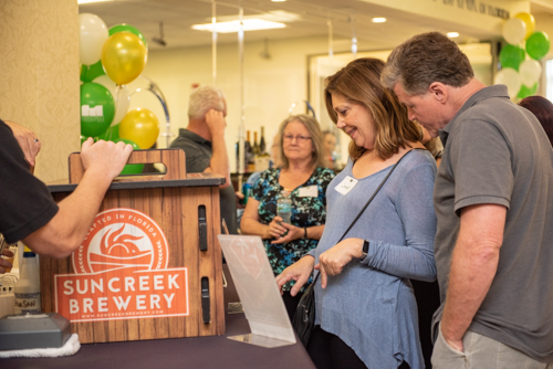 Guests decide which beverage they would like from Suncreek Brewery during Clermont's 2nd Anniversary Celebration