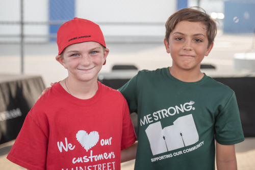 Two boys smiling for a picture before the Heart Walk.