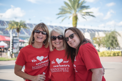 Members of Team Mainstreet smiling for a picture before the Heart Walk at Daytona International Speedway.