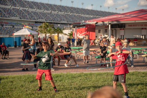 Younger members of Team Mainstreet hula hooping before the Heart Walk at Daytona International Speedway