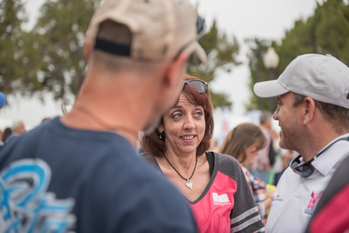 Woman looks at man during conversation at Pig on the Pond event