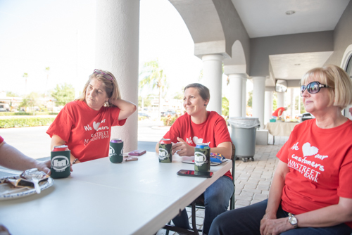 East Volusia team members sit and eat during customer appreciation day