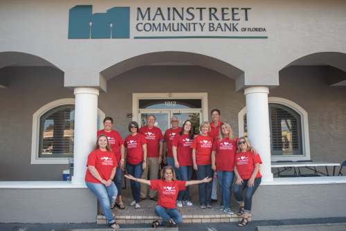 East Volusia team members pose for a picture outside of Mainstreet Community Bank