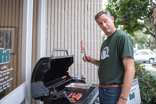 Orange City Team Member grills hot dogs for Customer Appreciation Day