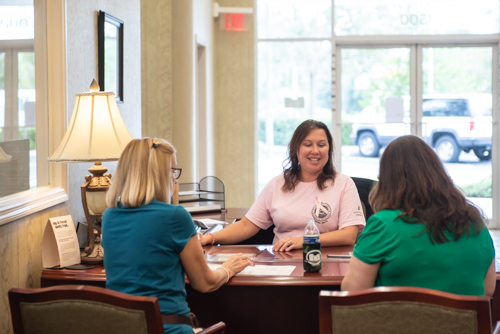 Team member helps two customers at Mainstreet Community Bank of Florida