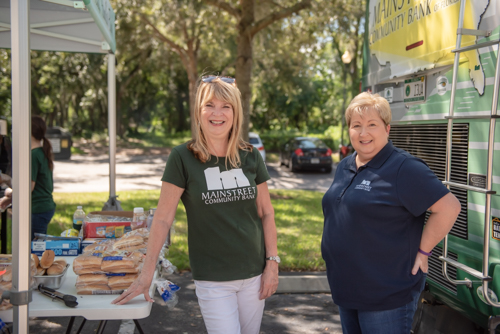 Women pose for a picture at Fall Customer Appreciation Day in DeLand
