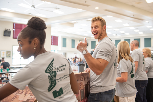 Man gives enthusiastic thumbs up while serving lunch to DeLand High School teachers