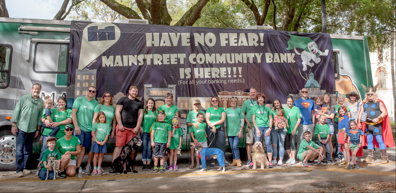 Group photo of Team Mainstreet before Mardi Gras Dog Parade in DeLand