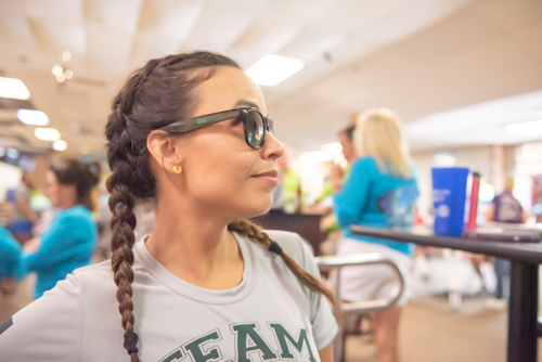A woman shows off her Mainstreet Community Bank sunglasses at bowling alley