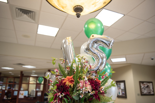 Balloons in the shape of a 1 and a 5 displayed during customer appreciation day in Orange City