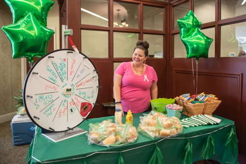 Team member smiles while giveaway wheel spins at Customer Appreciation Day