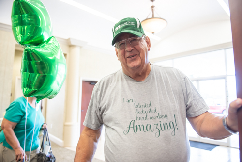 Man smiling wearing Mainstreet Community Bank hat in North Spring Garden branch
